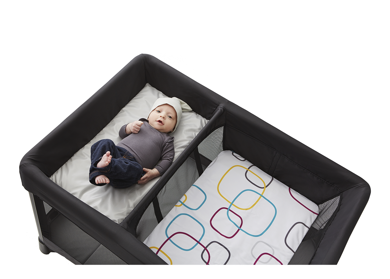 baby in removable bassinet next to changer