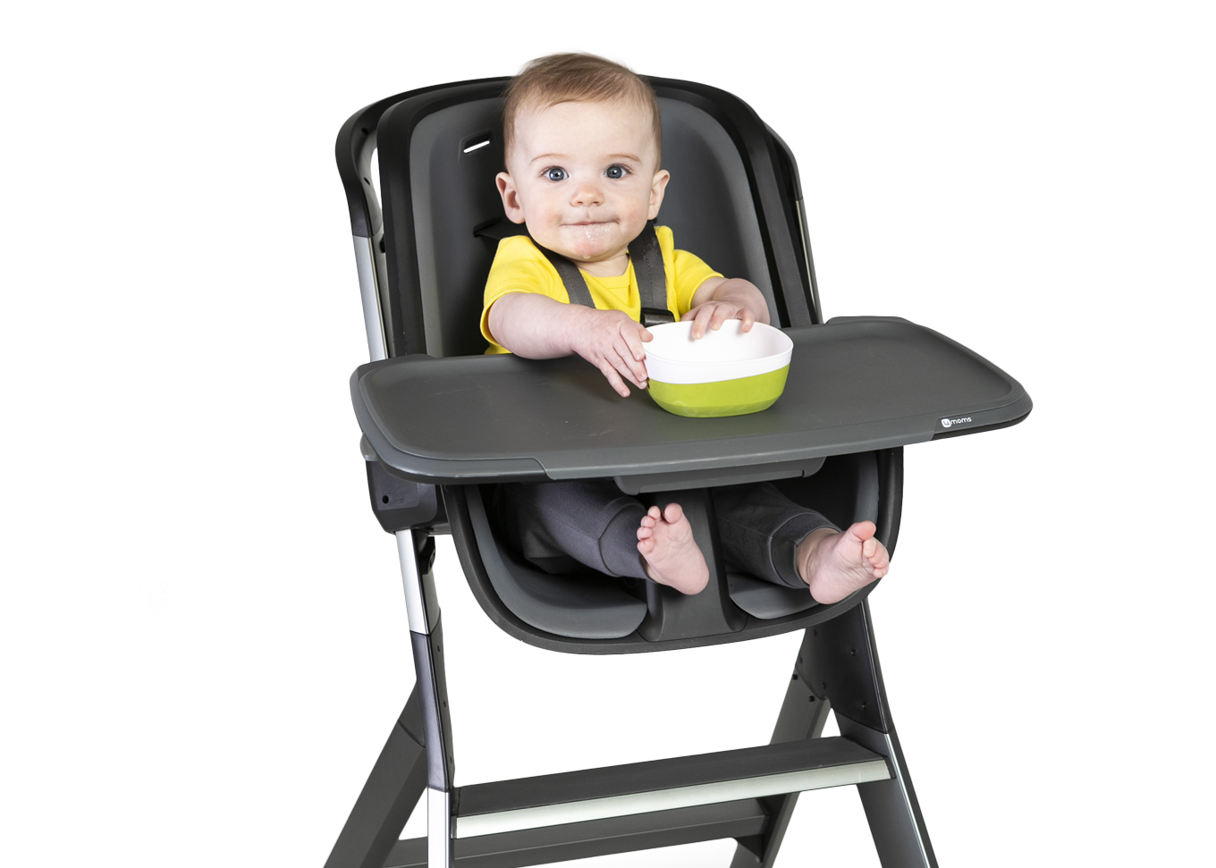 baby in high chair with magnetic tray holding bowl in place